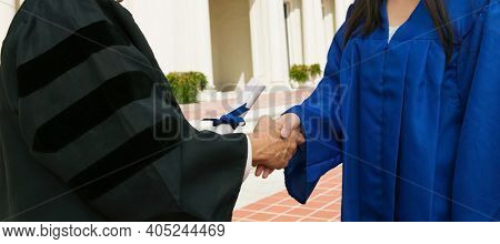 Cropped photo of Graduate Receiving Diploma