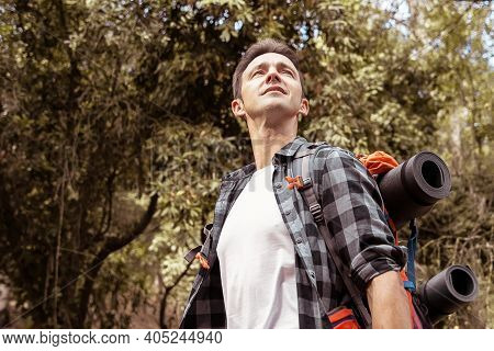 Hiking Man Looking At Nature Landscape. Attractive Caucasian Young Tourist With Backpack Enjoying Sc
