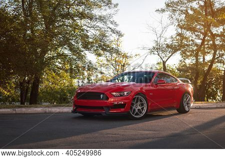 Odessa, Ukraine - August 2020. Powerful American Muscle Car Ford Mustang Gt 5.0 In A Red Color In Th