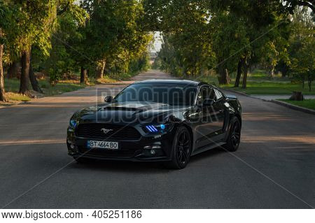 Kherson, Ukraine - July 2018. Powerful American Muscle Car Ford Mustang With Blue Headlights.