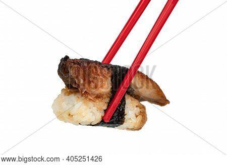 Unagi Or Eel Nigiri Sushi With Red Chopsticks Isolated On White Background