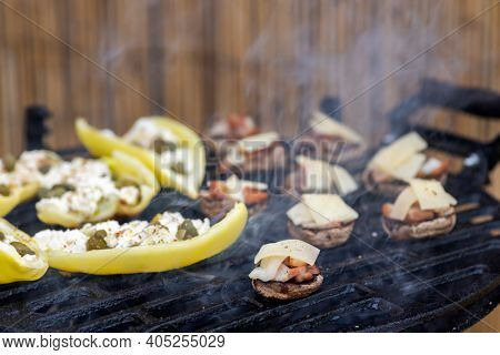 grilled peppers with feta cheese and capers and mushrooms with bacon baked with Emmental cheese