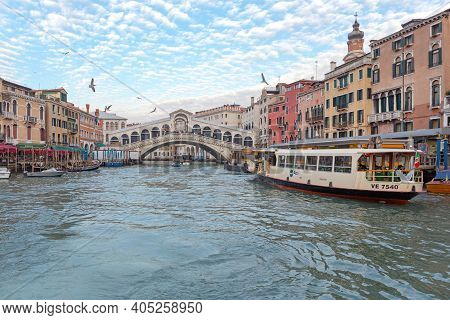 Venice, Italy - January 9, 2017: Public Transport Water Bus At Rialto Bridge Station Grand Canal In