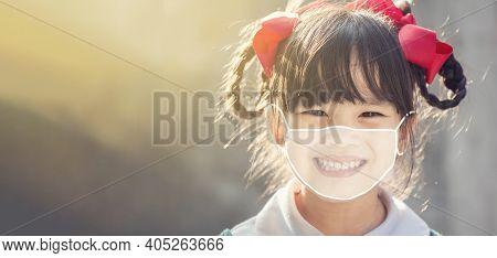 Little Chinese Girl Wearing Face Mask  Happy At School. Covid-19 Coronavirus.