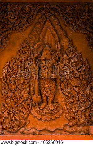 Ganesha On The Walls Of A Buddhist Temple On Koh Samui. Wat Ratchathammaram, One Of The Iconic Templ