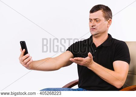Senior Man With Hearing Aid Communicates Non-verbally Via Video Call. White Background With Empty Sp