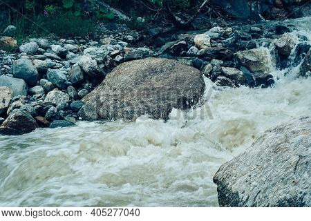Close Up Of Rapid Clean Stream Flowing On Rocks. Mountain River Flows Down And Splashes.