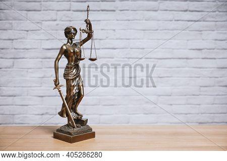 Lady Justice Or Justitia The Goddess Of Justice Statue On Desk - Legal Law Legislation Concept - Bri