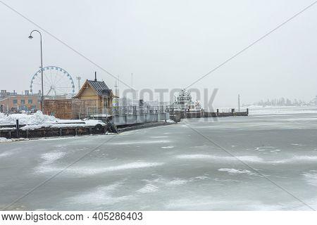 Finland, Helsinki. January 26, 2021 Helsinki Embankment In Winter, Frozen Sea. High Quality Photo