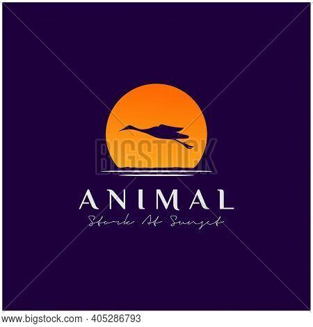 Flying Stork Heron Bird On River Lake Creek Sunset Logo Design