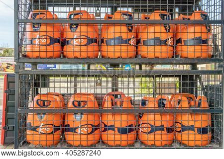 Campos, Spain; January 23 2021: Repsol Butane Cylinders In A Metal Cage Belonging To A Gas And Servi