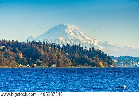 A View Of A Point With Trees And Mount Rainier In Burien, Washington.