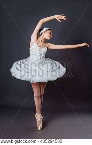 Portrait Of Young Beautiful Graceful Caucasian Ballerina Practice Ballet Positions In Tutu Skirt Of