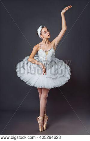 Ballerina Dancing In White Dress. Color Photo. Graceful Ballet Dancer Or Classic Ballerina Dancing I