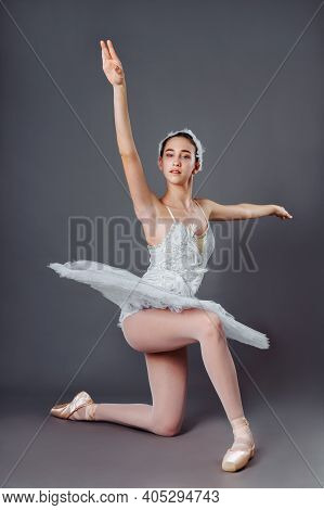 Ballerina Dancing In White Dress. Color Photo. Graceful Ballet Dancer Or Classic Ballerina Dancing I