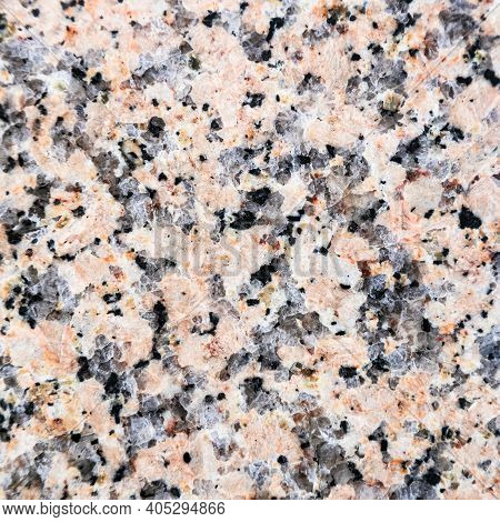 Square Background From Polished Slab Of Natural Pink Granite