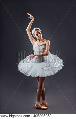 Graceful Ballet Dancer Or Classic Ballerina Dancing Isolated On Grey Studio Background. The Dance, G