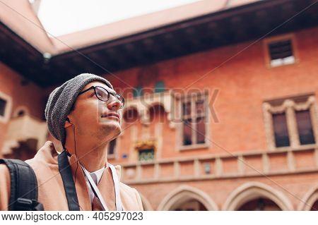 Man Tourist Enjoying Excursion In Medieval Jagiellonian University, Collegium Maius, Krakow, Poland