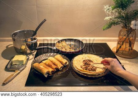 Cooking Homemade Russian Pancakes Bliny With Meat On Shrovetide - Maslenitsa. Woman Cooks Pancakes I