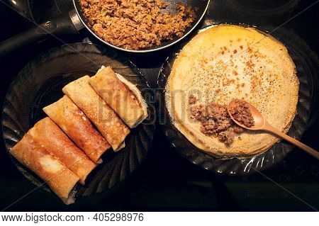 Cooking Homemade Russian Pancakes Bliny With Meat On Shrovetide - Maslenitsa. Cooking At Home