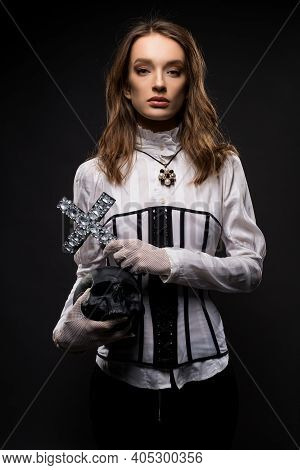 Fashionable Young Woman With Skull And Cross