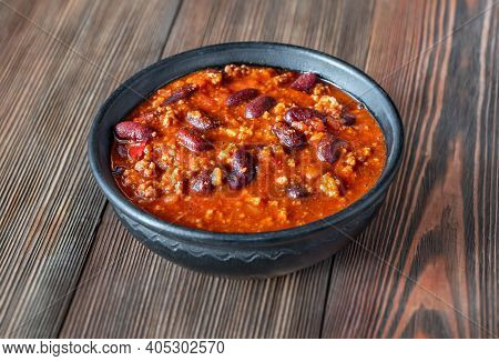 Bowl Of Chili Con Carne On A Wooden Table