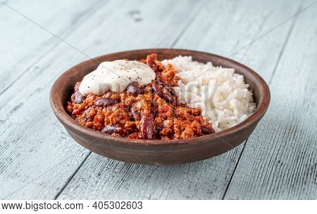 Bowl Of Chili Con Carne With Rice And Sour Cream
