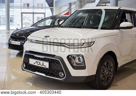 Russia, Izhevsk - December 28, 2020: Kia Showroom. New Ceed Sw And Soul In Dealer Showroom. Front An