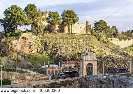 Toledo / Spain - January 23rd, 2020: Tourist Buses Arriving At Castillo San Servando Castle In Backg