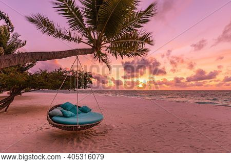 Tropical Beach Sunset Landscape With Beach Swing Or Hammock Hanging On Palm Tree With Sunset Sky Whi