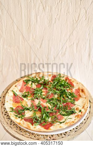 Italian Pizza With Duck From Wood-burning Stove. Lunch In An Italian Restaurant. Table Near To A Lar