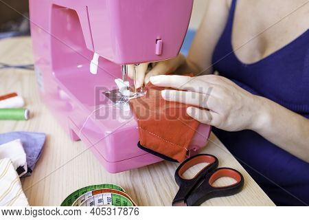 Woman Working With Sewing Machine Doing Homemade Medical Face Mask For Preventing And Stop Corona Vi