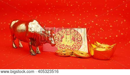 Tradition Chinese 2021 is year of the ox, Chinese characters on rightside gold ingot and coin translation:good bless for money.characters on middle mean: good bless for new year