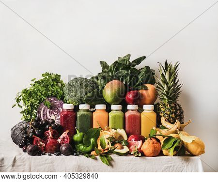 Variety Of Fresh Colorful Smoothies For Detox Weight Loss Diet. Juices In Vacuum Bottles With Fruit,