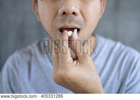 Young Man Take Medicine To Relieve Sickness, Male Taking Painkiller To Relieve Sickness