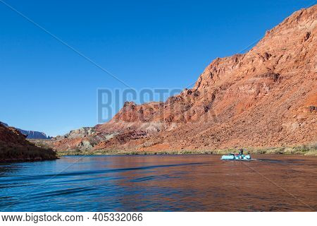 Glen Canyon, Arizona / Usa - October 30, 2014:  A Tour Guide Points Down River While Taking People O