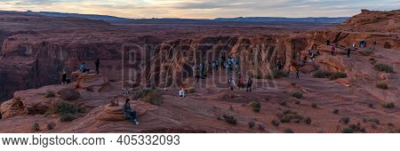 Horseshoe Bend, Arizona / Usa - October 30, 2014:  People Lined Up At Sunset On The Steep Canyon Cli