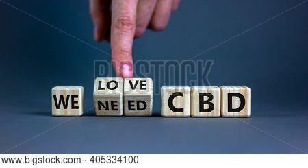 We Love Cbd, Cannabidiol Symbol. Hand Turns Cubes And Changes Words 'we Need Cbd' To 'we Love Cbd'.
