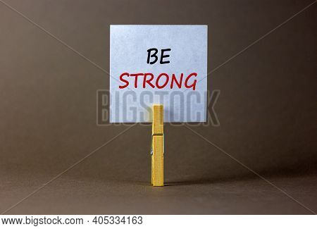 Be Strong Symbol. Wooden Clothespin With White Sheet Of Paper. Words 'be Strong'. Beautiful Grey Bac