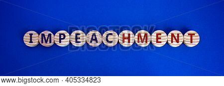 Impeachment Symbol. Wooden Circles With The Word 'impeachment'. Beautiful Blue Background, Copy Spac
