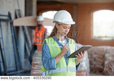A Construction Industry Maintenance Engineer Is A Pretty Woman Dressed In A Uniform And Protective H