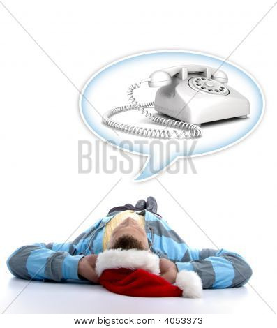 Man With Christmas Hat Watching Telephone