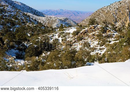 Alpine Meadow Covered With Snow Overlooking Mountainous Terrain Overlooking The Mojave Desert Taken