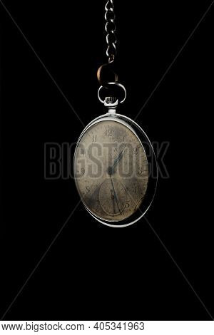 Old Pocket Chain Watch On Black Background