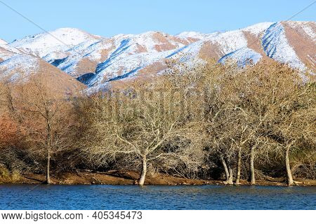 Lake Surrounded By Barren Mountains Covered With Snow Taken At The Mojave Desert In Hesperia, Ca