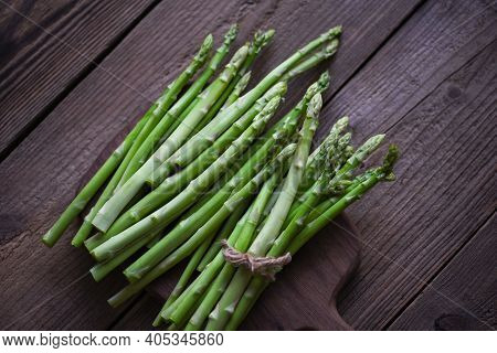 Asparagus Bunch For Cooked Food, Bundle Of Fresh Green Asparagus On A Rustic Wooden Table