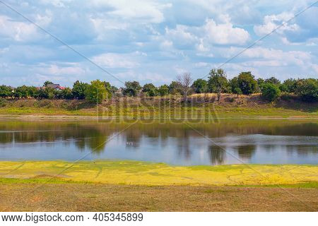 Rustic Scenery With Pond ,  Village Situated At The Riverside