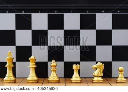 Gold Set Chess Piece Stand On Wood Chessboard