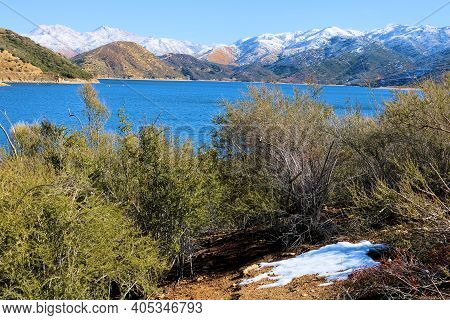Mountains Covered With Snow Surrounding Silverwood Lake, Ca Taken On Arid Badlands At A Chaparral Wo