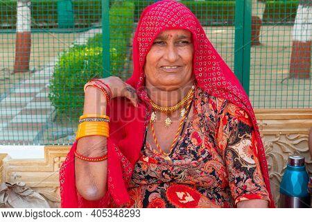 Jaisalmer, Rajasthan, India - 15th October 2019 : Smiling Rajatshani Woman With Colourful Dress At T
